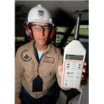 Industrial Hygene Officer and Assistant Safety Officer uses a sound level meter to demonstrate the high deci