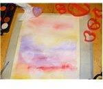 Paint background, add heart imprints