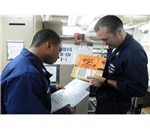 777px-US Navy 101116-N-3666S-079 Logistics Specialist 2nd Class Travis Bradford, left, and Logistics Specialist 1st Class Todd Tudor (1)