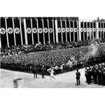 Runner bringing the Olympic flame into the Reich Sports Field in the 1936 Olympics in Berlin: Courtesy of Stanford University
