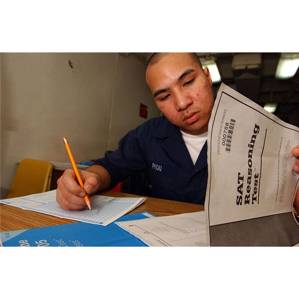 800px-US Navy 050223-N-5821P-054 Seaman Chanthorn Peou of San Diego, Calif., takes his Scholastic Aptitude Test (SAT) aboard the conventionally powered aircraft carrier USS Kitty Hawk (CV 63)