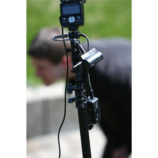 light stand with speedlight, pocketwizard, radiopopper, and pc sync cord