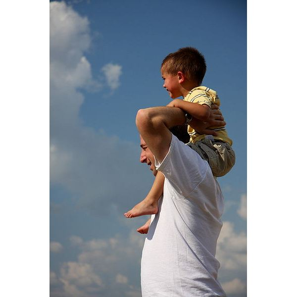 Son on father's shoulders.