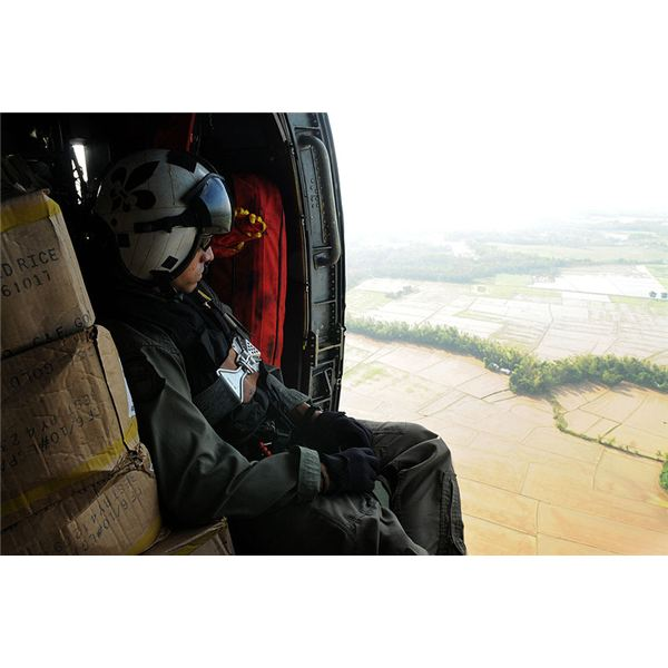 800px-US Navy 080626-N-4009P-688 Aviation Warfare Systems Operator 2nd Class Anthony Chavez, of San Bernardino, Calif., looks over flooded areas in the Republic of the Philippines