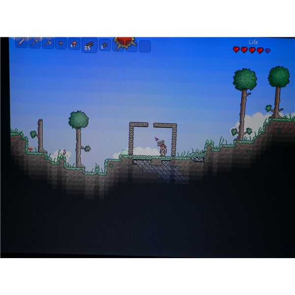 Building shelter at the start of the game in Terraria.