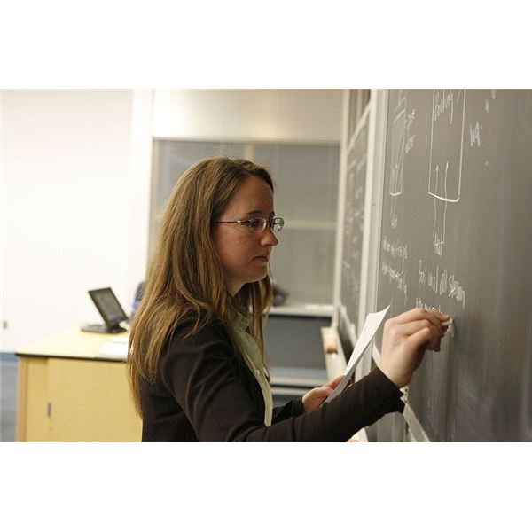 800px-Teacher writing on a Blackboard
