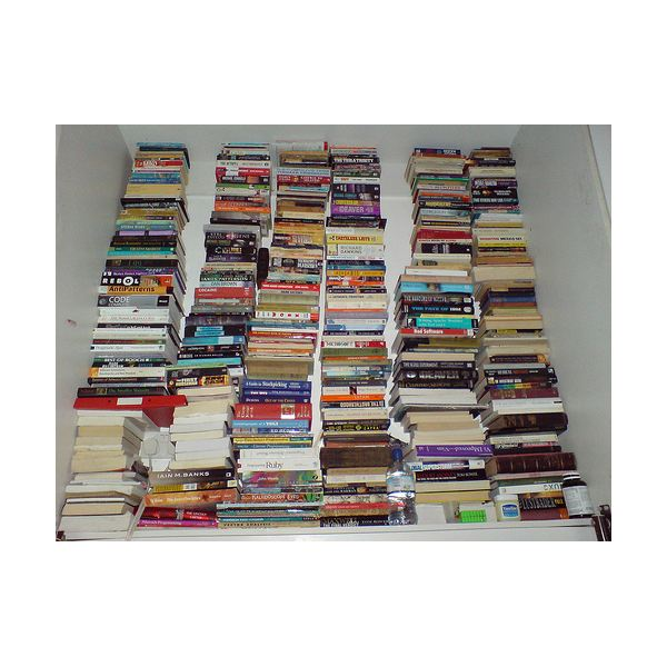 A stack of unused books, taking up space.