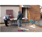 800px-Carpenters repair a door arp