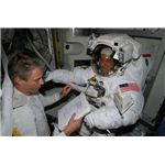 Astronaut suiting up on the ISS- Courtesy of NASA