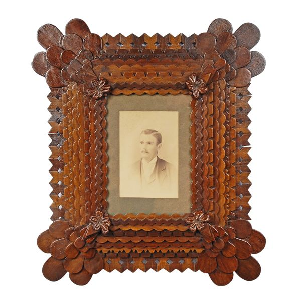 Tramp art frame with maker's photograph