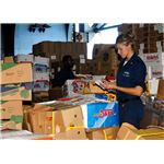 800px-US Navy 081002-N-2074H-072 Information Systems Technician 3rd Class Isabella Concepcion inventories crates of fruit and vegetables