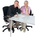 man and woman at desk BE uid 1354224