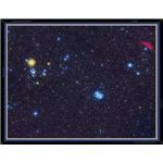 This photo of the constellation Taurus shows, enlarged in their true color, the main