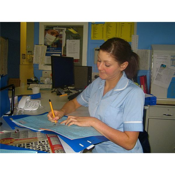 800px-Staff Nurse Andrea writing up her notes