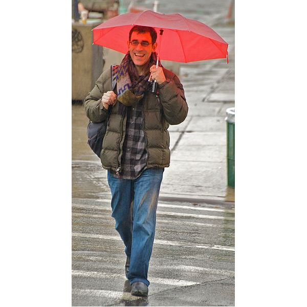 Happy man in a rainy day - You'd smile, too, if you just got a job after being unemployed for the last six months!