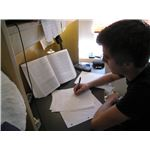 Studying in College (Photo Credit: Wikimedia Commons)