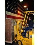 450px-US Navy 030407-N-5821W-001 Storekeeper Seaman Estella Perez operates a forklift in order to weigh a pallet of Tastykake snacks