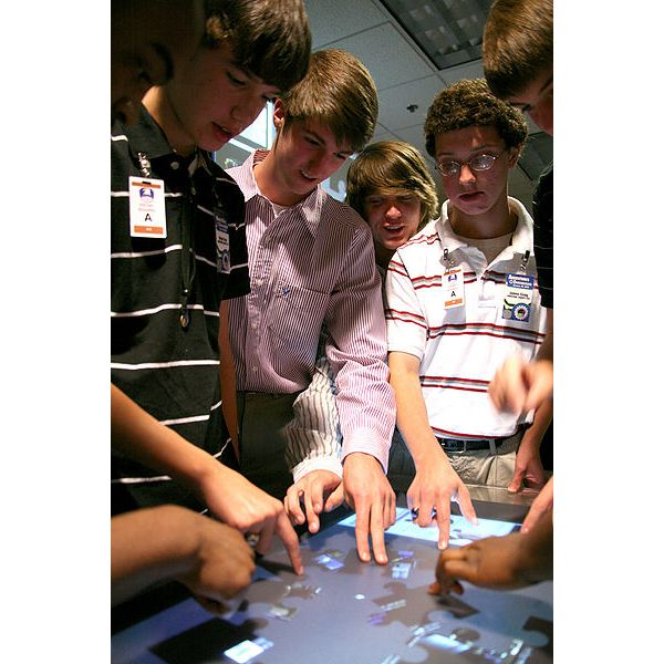 400px-US Army 52288 Trey McMeans (second from the left) from Clements High School tests the Virtual Sandbox table-top display with fellow classmates
