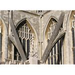 Close-up of two flying buttresses at Bath Abbey, Bath, England. Taken by Adrian Pingstone in March 2005, and released to the public domain.