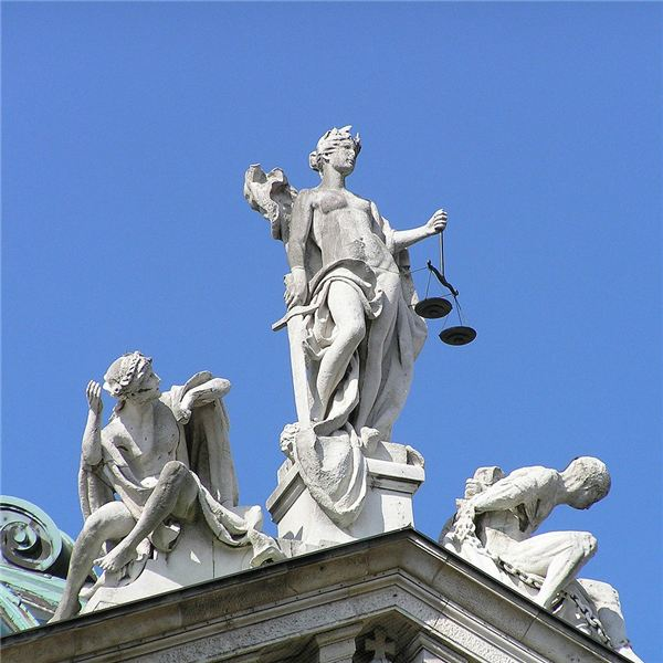 Justitia, on top of the southern gable of the Palace of Justice, Munich, Germany.