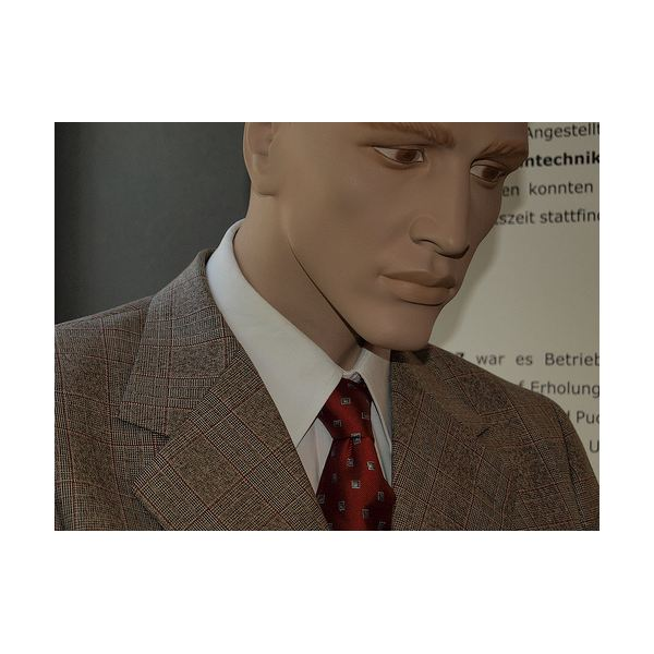 A mannequin in business attire.