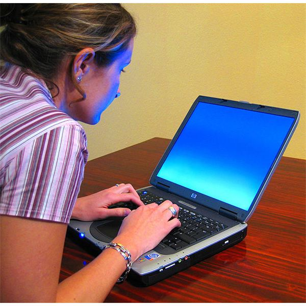 Woman Typing On Laptop (Image Credit: Wikimedia Commons)