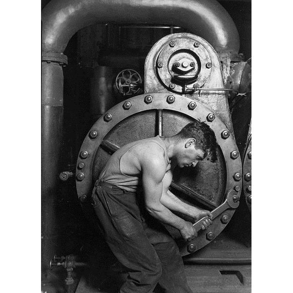 431px-Lewis Hine Power house mechanic working on steam pump