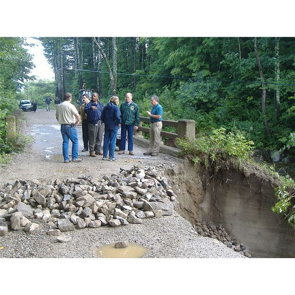 800px-FEMA - 37472 - Disasters officials inspecting road damage in Vermont