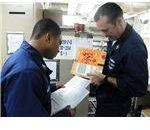777px-US Navy 101116-N-3666S-079 Logistics Specialist 2nd Class Travis Bradford, left, and Logistics Specialist 1st Class Todd Tudor