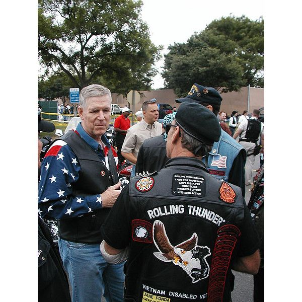 450px-US Navy 040530-N-0000L-002 Chairman of the Joint Chiefs of Staff, Gen. Richard B. Myers, talks with a fellow motorcycle enthusiast and Vietnam veteran