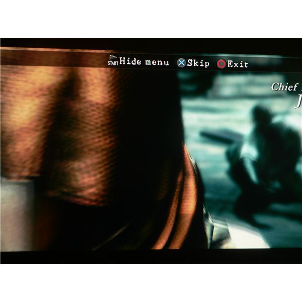 A mysterious woman and a villager being infected during the opening cutscene of Resident Evil 5.
