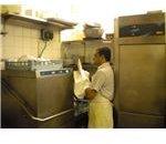 800px-Punjabi cook and dishwasher