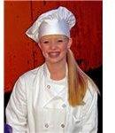 """Woman wearing a traditional chef's uniform"" by Matt/Wikimedia Commons"