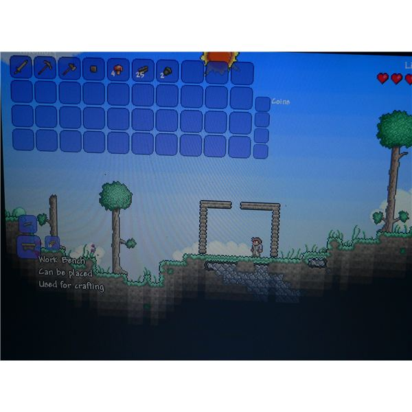 A look at the crafting menu in Terraria, where you can build a work bench.