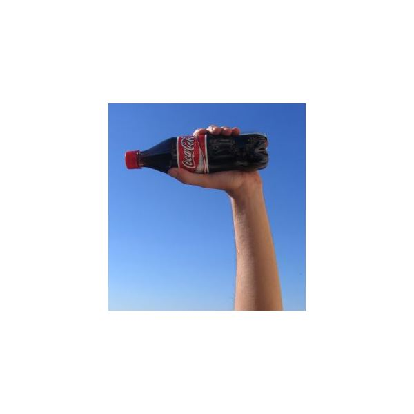 Hand with cola bottle