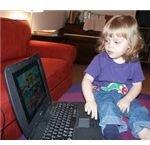 toddler on laptop