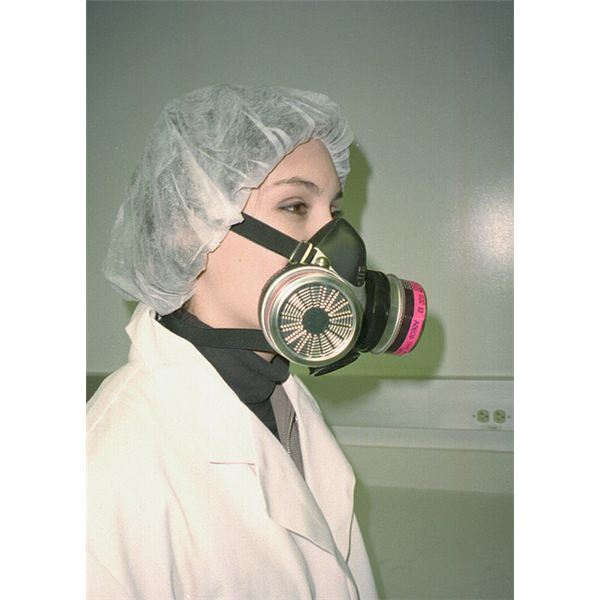 Worker wearing half-mask replaceable particulate filter respirator from Flickr by NIOSH