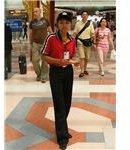 450px-Female Burger King employee Suvarnabhumi Airport Thailand