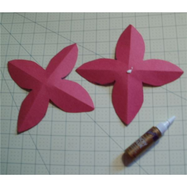 put a dot of glue on the bottom petal center