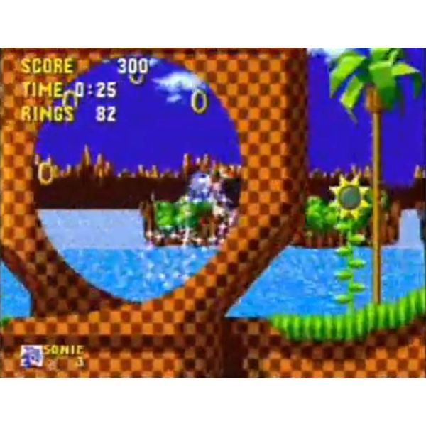 Sonic running through a loop-de-loop in Green Hill Zone, the game's first world.