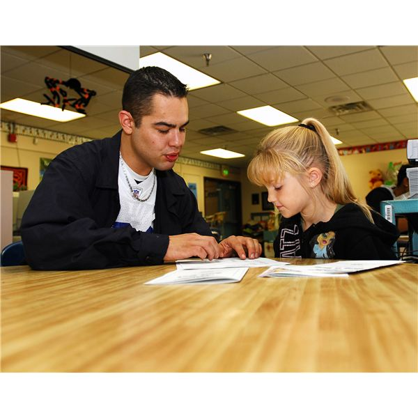 US Navy 071022-N-6538W-023 Machinist's Mate 3rd Class Joseph Herrera, tutors 1st graders at West Hills Elementary School