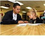 US Navy 071022-N-6538W-023 Machinist's Mate 3rd Class Joseph Herrera, tutors 1st graders at West Hills Elementary School