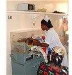 504px-Nurse checking triplets