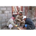 800px-US Navy 050105-N-1438S-010 Builder 3rd Class Christopher Ravella, assigned to Naval Mobile Construction Battalion Seventeen (NMCB-17), works alongside Iraqi students enrolled in the Iraqi Construction Apprentice Program (ICAP)