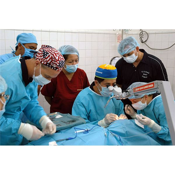 U. S. Navy Cmdr. David Lu performs delicate cataract surgery on a patient while members of the Philippine Navy medical team, along with U.S. Navy nurses and hospital corpsman assist and observe