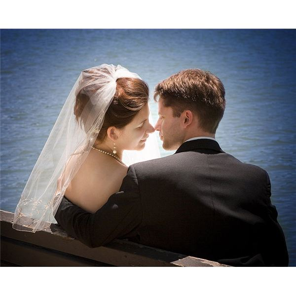 A newly-wed couple by the water.